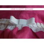white bow and ruffles b013